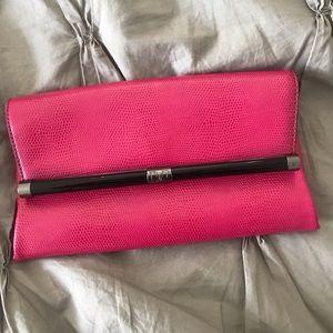 DVF hot pink clutch.